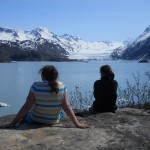 Students take in the glacier from a rocky outcropping